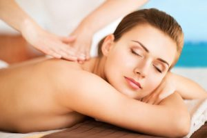 a woman relaxing through massage