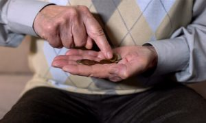 A man counting money for daily budgeting.